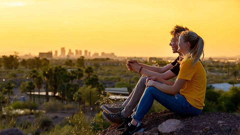 ASU students in a sunset.